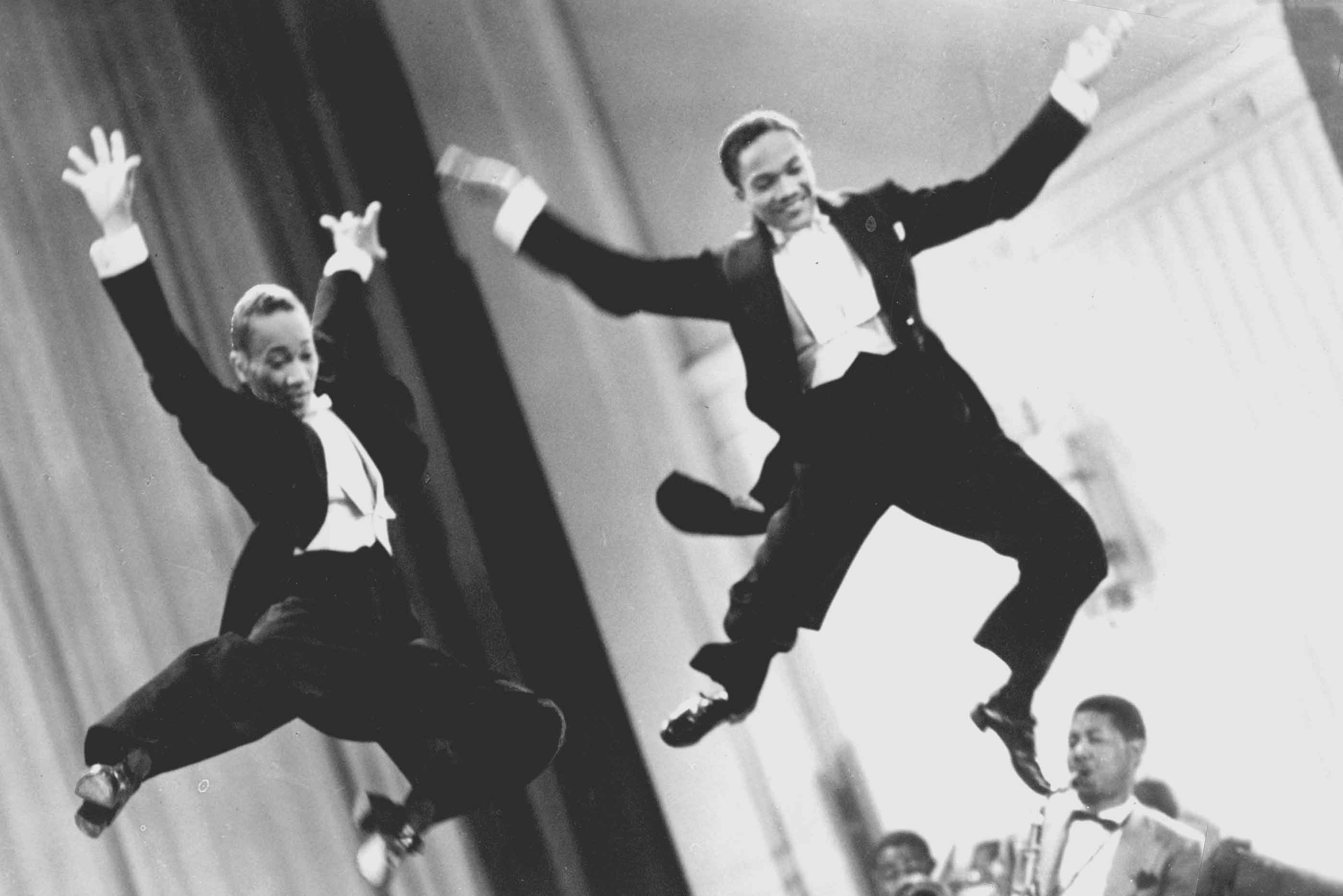 The Nicholas Brothers leaping mid air